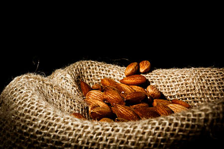 Almond nuts in a bag close up Stok Fotoğraf