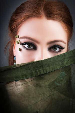 Beautiful young woman in makeup using cardamom