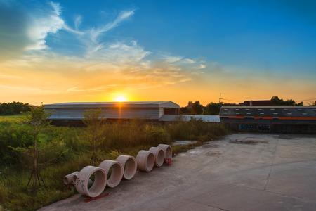 wasteland: Sunset over wasteland and warehouse Stock Photo