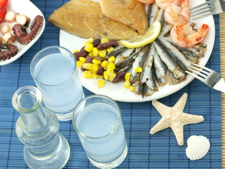 Fish and ouzo Stock Photo
