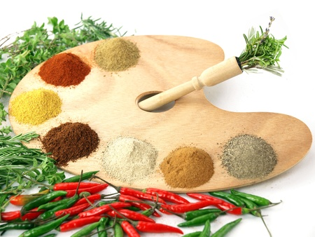 Herbs and spices on a wooden palette photo