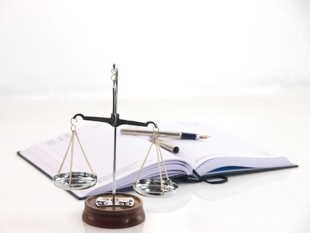 fairness: Scales of justice with books