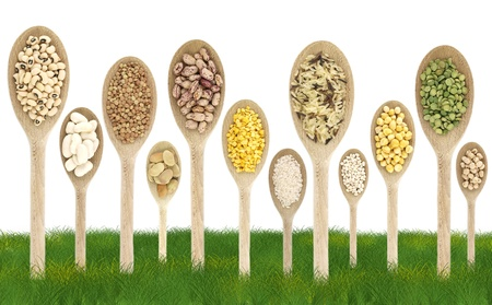 peas: Legumes over spoons like trees on a grass field Stock Photo
