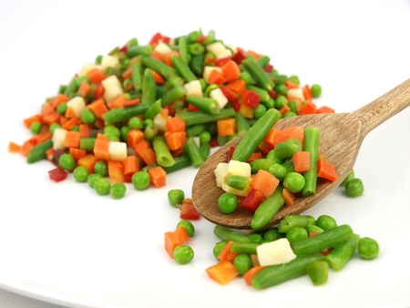 mixed vegetables: Mexican frozen vegetables on a wooden spoon Stock Photo