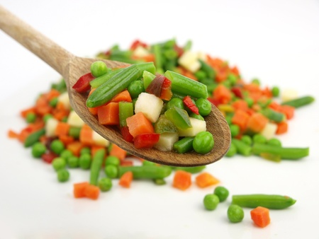 Mexican frozen vegetables on a wooden spoon Stock Photo - 9101762