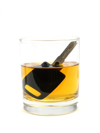 responsibly: A car key in a glass of whisky
