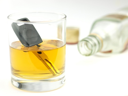 drink responsibly: A car key in a glass of whisky