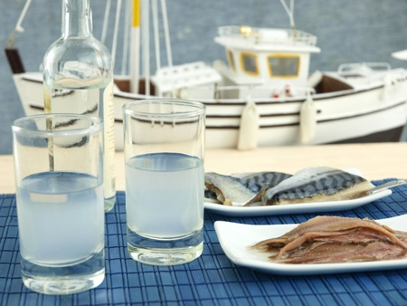 Ouzo and seafood near the beach Stock Photo