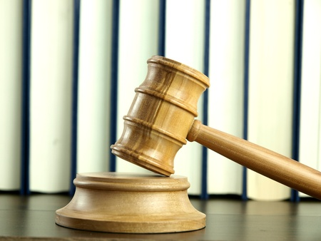 judgments: Judge�s Gavel and stack of legal books  Stock Photo