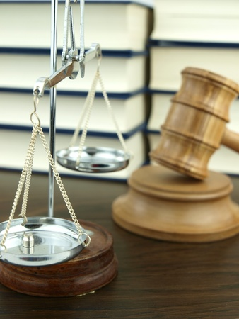 legal scales: Judge�s Gavel and scale of justice with a stack of legal books background Stock Photo