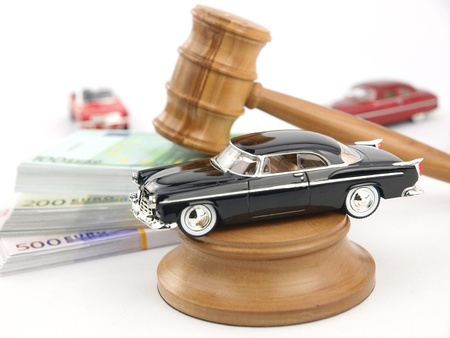 Gavel auction with antique car and money photo