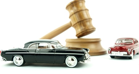 prosecution: Gavel auction with antiques cars