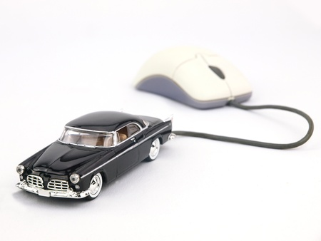 A car connected to a computer mouse  photo