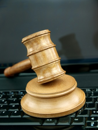 Auction gavel on a laptop keyboard  photo