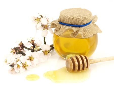 pollens:  Honey in a jar, flowers and honey dipper on white background Stock Photo