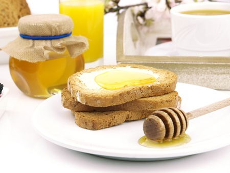 Honey on toast, with a breakfast set background Stock Photo - 9102770