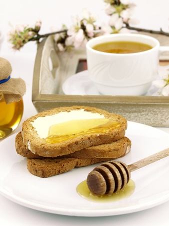 Honey on toast, with a breakfast set background Stock Photo - 9102789