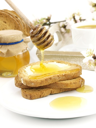Honey on toast, with a breakfast set background Stock Photo - 9102765