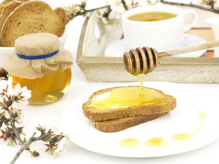 Honey on toast, with a breakfast set background Stock Photo - 9102768