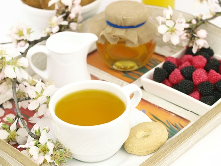 Healthy breakfast set on a wooden tray photo