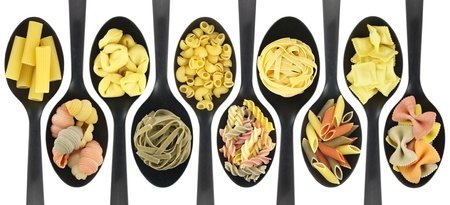 penne pasta: Misc raw pasta over spoons