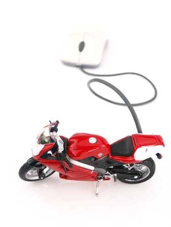 Motorcycle connected to a computer mouse  photo