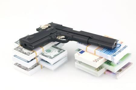 robbing: Gun and money on the white background Stock Photo