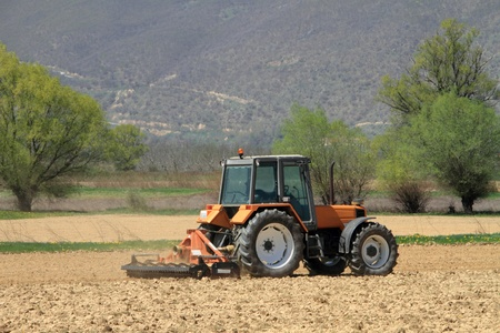 ploughing: A tractor ploughing a field