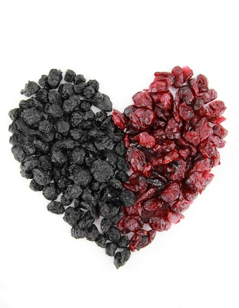 dried fruit: Heart of dried blueberries and cranberries isolated on white background Stock Photo