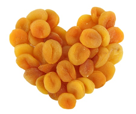 Heart of dried apricots isolated on white background photo