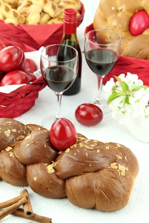recipe decorated: A traditional sweet brioche bread, called tsoureki, decorated with red eggs (Greek recipe)  Stock Photo