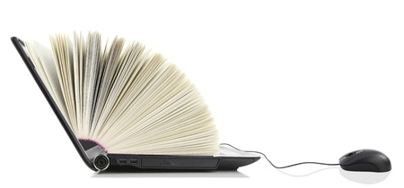 Laptop as a Book connected to a computer mouse photo