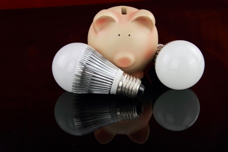 LED light bulbs with piggy bank Stock Photo - 9611537