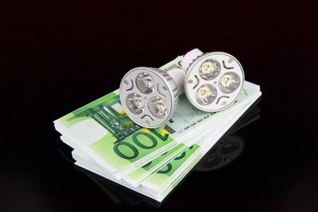 LED light bulbs with money photo