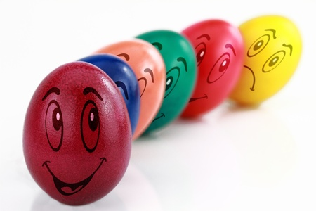 friends laughing: Colored Easter eggs with drawn funny faces in a row