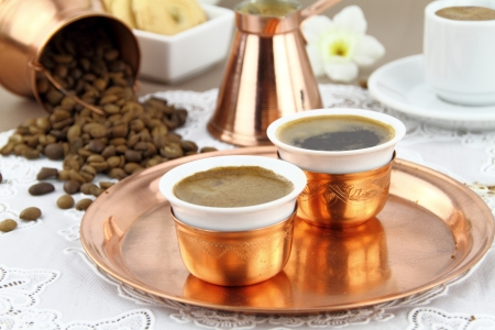 asian flavors: Table set with Greek or Turkish coffee in traditional crockery