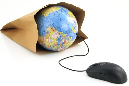 commerce: Computer mouse connected to a grocery bag with a world globe inside