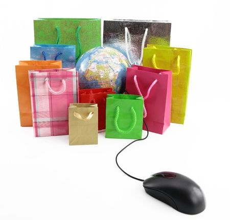 buy online: Computer mouse connected to a group of shopping bags with a globe inside