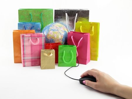 online shop: Computer mouse connected to a group of shopping bags with a globe inside