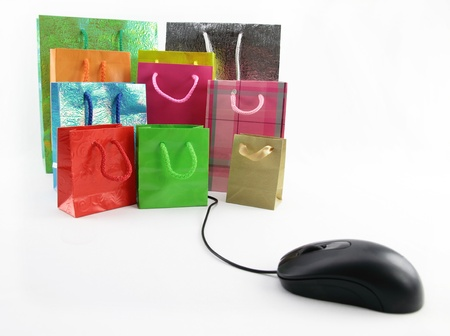 Computer mouse connected to a group of shopping bags Stock Photo - 9611539