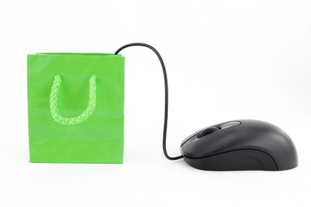 Computer mouse connected to a green shopping bag Stock Photo - 9611415