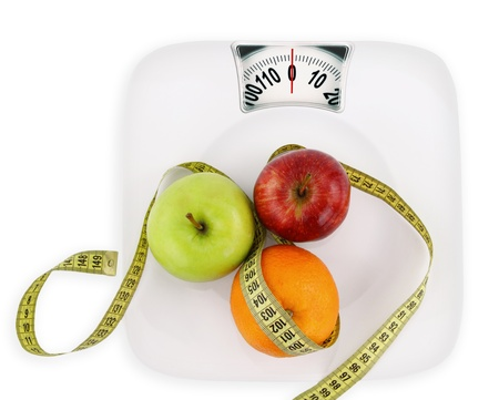 nutritionist: Diet concept. Fruits with measuring tape on a plate like weight scale