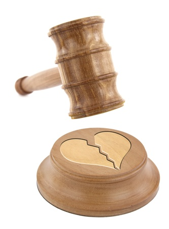 A judge's gavel coming down on a broken heart design photo