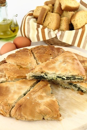 Homemade puff spinach pie with filo pastry photo