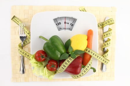 lose weight: Vegetables with measuring tape on a plate as weight scale