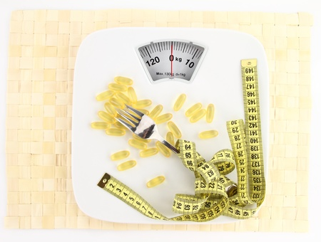 Vegetables with measuring tape on a plate as weight scale  photo