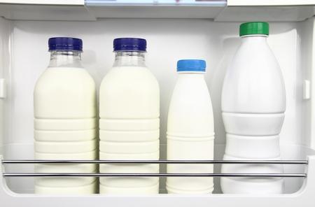 beverage fridge: Various bottles of milk in the fridge Stock Photo
