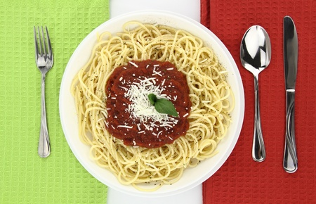 Spaghetti over Italian flag colors background photo
