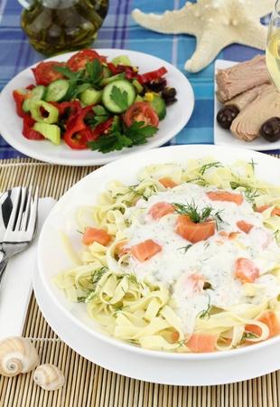 Tagliatelle pasta with cream, salmon and anise photo