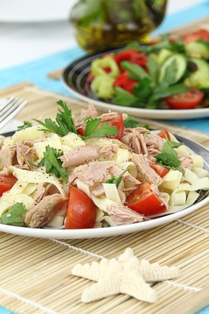 Tagliatelle pasta with tuna, parsley and cherry tomatoes photo